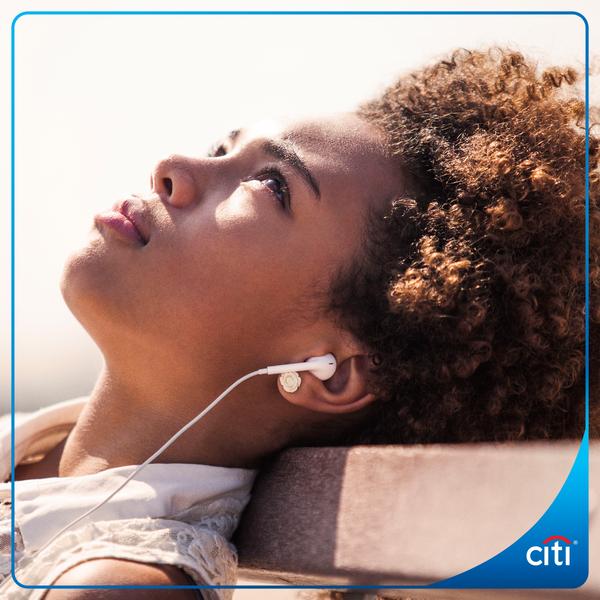 Image of melancholy woman wearing headphones, listening to music