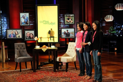 Image of the Kang sisters on the set of Shark Tank, pitching Coffee Meets Bagel to the sharks in hope of an investment.
