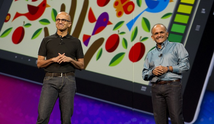 Photo of Microsoft CEO Nadella standing on stage with the CEO of Adobe