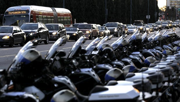 A lineup of LAPD motorcycles juxtaposed with a traffic jam