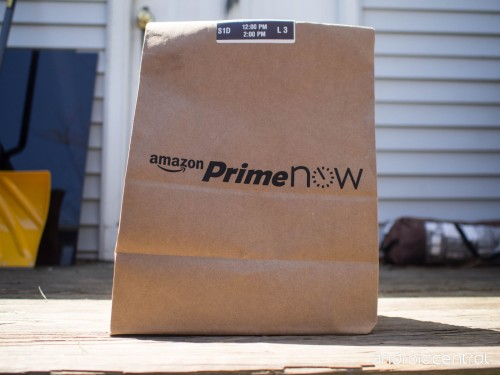 An Amazon Prime Now bag sitting on someone's doorstep